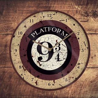 Harry Potter - Zegar Ścienny gadżety na parapetówkę zegar ścienny